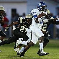 Aberdeen quarterback Fred Fields runs out of reach of Amory's Derrick Wade and Martavious Walker during Friday night's game at Amory.