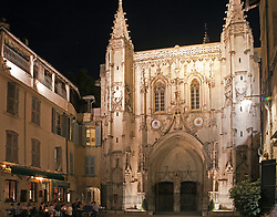 Diners at the gourmet restaurant L'Epicerie have a magnificent backdrop for their evening out.  Noted for its handsomely carved chestnut doors, the Church of St. Pierre dominates its quiet square, tucked away just a few hundred feet from the busy Place L'Horloge.