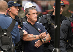 © Licensed to London News Pictures. 11/07/2019. London, UK. A supporter of Tommy Robinson is led away in handcuffs by police. Supporters of activist Stephen Yaxley-Lennon Known as Tommy Robinson, gather outside The Old Bailey in London ahead of his sentence. The former leader of the English Defence League (EDL) is being sentenced for contempt of court for filming defendants at a trial at Leeds Crown Court and broadcast the video on social media. Photo credit: Ben Cawthra/LNP