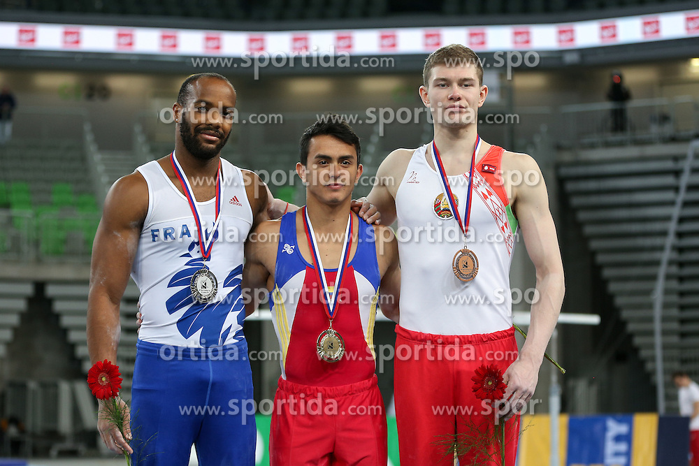 Winner Jossimar Orlando Calvo Moreno of Columbia, second place for Axel Augis and third place for Vasili Mikhalitsyn of Belarus in Parallel bars during Final of Artistic Gymnastics World Challenge Cup Ljubljana, on April 5, 2015 in Arena Stozice, Ljubljana, Slovenia. Photo by Morgan Kristan / Sportida