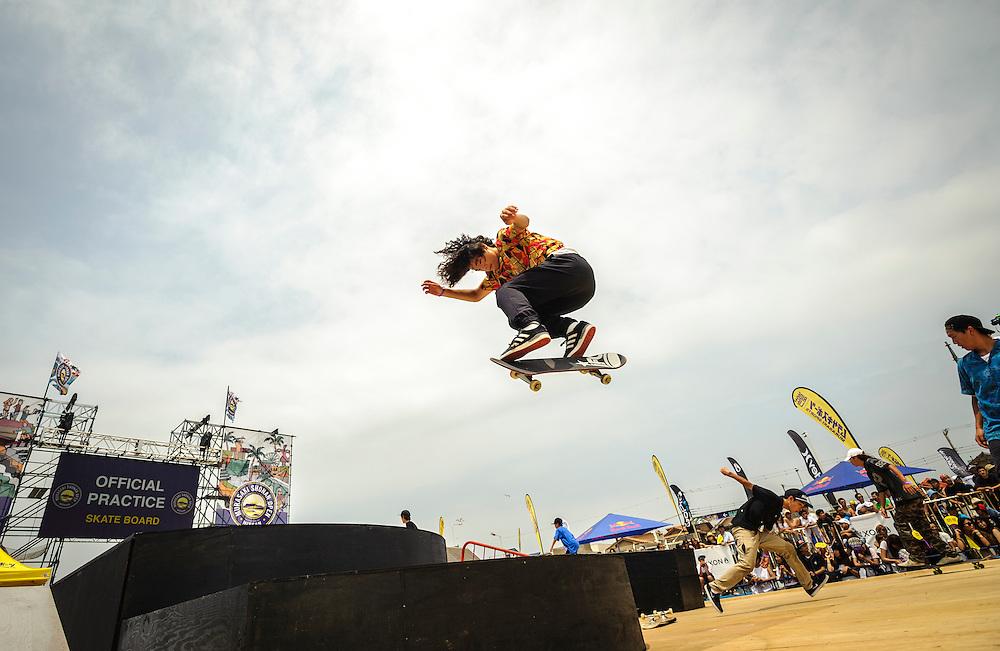 A skater performs tricks at the Shonan Open street skateboarding competition at Kugenuma Beach in Fujisawa, Kanagawa Prefecture, Japan.
