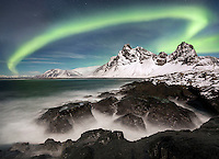 Aurora borealis display over the eastern fjords of Iceland.