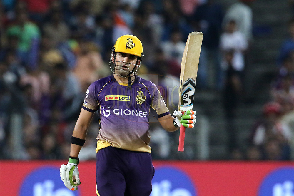 Kolkata Knight Riders captain Gautam Gambhir raises his bat after scoring a fifty during match 30 of the Vivo 2017 Indian Premier League between the Rising Pune Supergiants and the Kolkata Knight Riders  held at the MCA Pune International Cricket Stadium in Pune, India on the 26th April 2017<br /> <br /> Photo by Vipin Pawar- IPL - Sportzpics