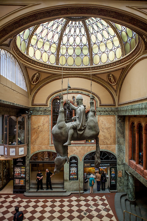 "Lucerna Passage - in the middle the ""Dead Horse"" which is a sculpture from Czech sculptor and contemporary artist David Cerny. It is a parody of the statue of St. Wenceslas on Wenceslas square some 200 meters away. It can be found in the passage Lucerna Kavarna."