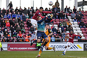 Northampton Town forward Vadaine Oliver (19) battles for possession  with Port Vale goalkeeper Scott Brown (1) during the EFL Sky Bet League 2 match between Northampton Town and Port Vale at the PTS Academy Stadium, Northampton, England on 8 February 2020.