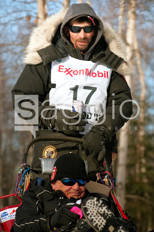 Musher Lance Mackey and Iditarider Alan Docter ride along the Chester Creek Trail during the 2011 Iditarod Ceremonial Start.