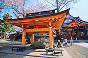 The Gojunoto Temple in Hirosaki northern Japan. It is spring time and surrounded with beautiful cherry blossoms and buddhist statues.