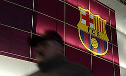 A fan walks past the Barcelona Badge outside Camp Nou - Photo mandatory by-line: Dougie Allward/JMP - Mobile: 07966 386802 - 18/03/2015 - SPORT - Football - Barcelona - Nou Camp - Barcelona v Manchester City - UEFA Champions League - Round 16 - Second Leg