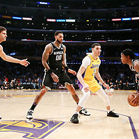 09 January 2018: Los Angeles Lakers guard Lonzo Ball (2) defends on Sacramento Kings guard De'Aaron Fox (5) next to Sacramento Kings center Willie Cauley-Stein (00) and Los Angeles Lakers center Brook Lopez (11) during the LA Lakers 99-86 victory over the Sacramento Kings, at the Staples Center, Los Angeles, California, USA.