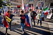 """Roma 3 Ottobre 2015<br /> Manifestazione a sostegno del Presidente russo Putin, a  Piazzale Flaminio,  """"Io sto con Putin"""" , per sconfiggere il terrorismo islamico, per fermare la crisi migratoria, per ritrovare la sovranità"""". I manifestanti chiedono anche l'immediata rimozione delle sanzioni alla Russia. La manifestazione è organizzata dal Comitato Italia-Russia e dal Vladimir Putin Italian Fan Club. Manifestanti pro Putin allontanano una donna ucraina con la bandiera rossa e nera che era stata utilizzata dai collaborazionisti ucraini con la  Germania nazista.<br /> Rome, October 3, 2015<br /> Rally in support of Russian President Putin, Piazzale Flaminio, """"I'm with Putin"""", to defeat Islamic terrorism, to stop the migration crisis, to regain sovereignty.The protesters are also demanding the immediate removal of sanctions on Russia.The event is organized by the committee Italy-Russia,  and  from Vladimir Putin the Italian Fan Club. Demonstrators pro Putin hunt a Ukrainian woman with red and black flag, that was used by Ukrainian collaborators with Nazi Germany."""