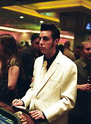 Retro 50's man in a sharp suit gambling at a casino, Las Vegas, USA, 2000's