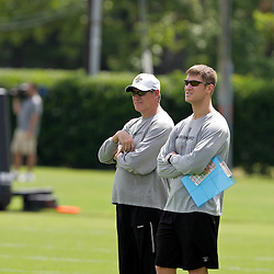 08 May 2009: Saints general manager Mickey Loomis (left) observes drills during the New Orleans Saints  rookie minicamp held at the team's practice facility in Metairie, Louisiana.