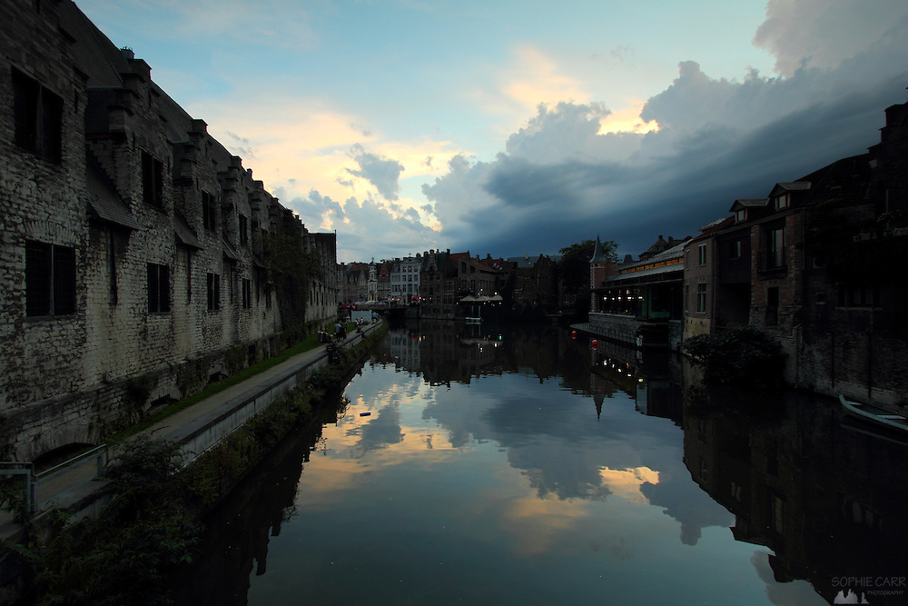Dusk looking south over the River Leie in Ghent, in the East Flanders region of Belgium. The Great Butchers' Hall is on the left of the image