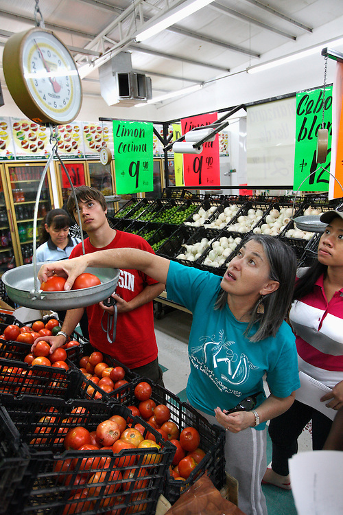 People buy vegetables at a store (tienda) in Agua Perieta, Mexico.