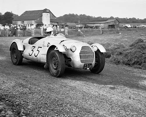 Jaguar Special driven by Charles M. Schott of Brookside, NJ, looks back around tight corner to see his competition while winning final race at Callicoon, NY, 1953. Photo by Ozzie Lyons 1953 © petelyons.com
