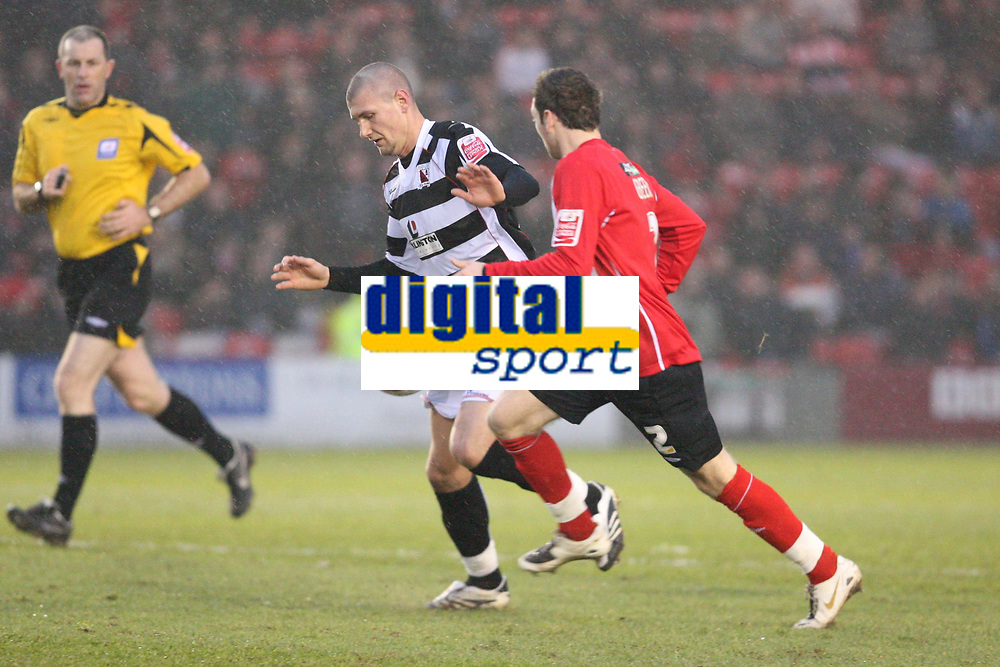 Photo: Pete Lorence/Sportsbeat Images.<br />Lincoln City v Darlington. Coca Cola League 2. 22/12/2007.<br />Paul Green watches on as Tommy Wright brings the attack forward for Darlington.
