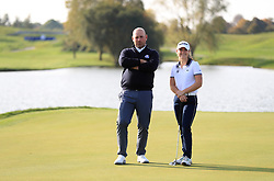 European captain Thomas Bjorn with a member of the Europe Junior Ryder Cup team hits a few practice balls during a media event ahead of the 2018 Ryder Cup at Le Golf National, Paris.