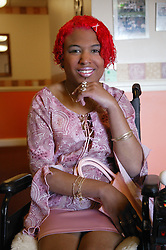 Young woman with disability; wheelchair user,