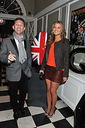 NICK CANDY and HOLLY VALANCE at a champagne reception to launch The Big Egg Hunt presented by Faberge in aid of the charities Action for Children and Elephant Family held at 29 Portland Place, London on 18th January 2012.