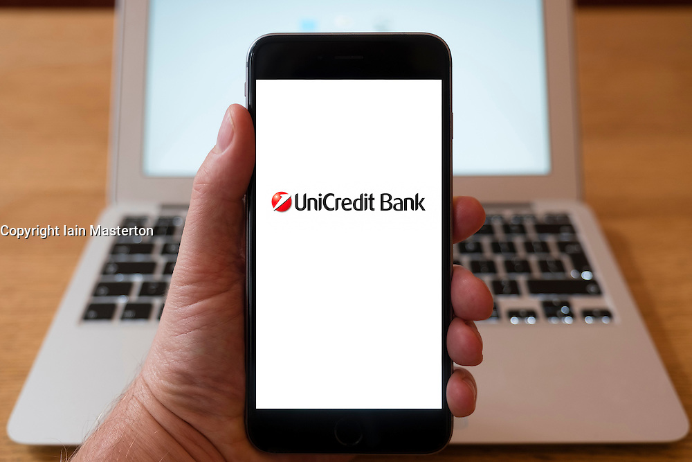 Using iPhone smartphone to display logo of UniCredit Bank, the Italian global banking and financial services company