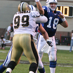 26 August 2006: Indianapolis Colts quarterback Peyton Manning (18) throws as New Orleans Saints defensive tackle Hollis Thomas provides pressure during a NFL preseason game between the Indianapolis Colts against the New Orleans Saints at Veterans Memorial Stadium in Jackson, Mississippi.