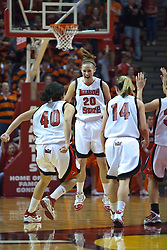 28 March 2010: With just 19 seconds left, Katie Broadway reacts after hitting a  3 point game winning shot as Ashleen Bracey and Amanda Clifton rush to congratulate her. The Redbirds of Illinois State squeak past the Illini of Illinois 53-51 in the 4th round of the 2010 Women's National Invitational Tournament (WNIT) on Doug Collins Court inside Redbird Arena at Normal Illinois.