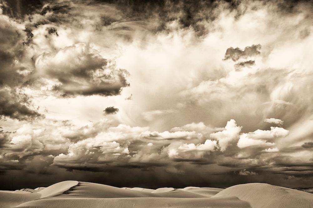 Sahara desert sand dunes with cloudy sky.