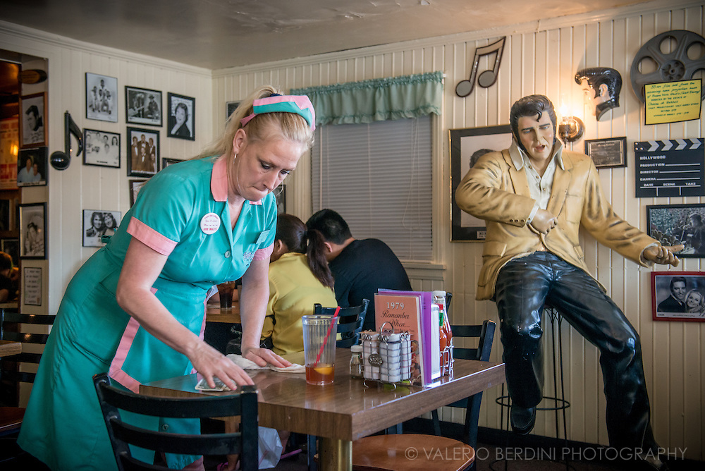 A waitress grab her tip while cleaning a table of Peggy Sue's Diner. This original1954 restaurant sets in on the shadow of the Calico Mountains and was built from railroad ties and mortar from the nearby Union Pacific Rail yard.