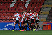 Rob Dickie celebrates his 1st goalduring the FA Trophy match between Cheltenham Town and Chelmsford City at Whaddon Road, Cheltenham, England on 12 December 2015. Photo by Antony Thompson.