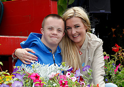 Repro Free: 30/06/2013 <br /> Jamie Murnane (16) from Laoise is pictured with actress Sorcha Furlong pictured at the Gardenworld Kilquade inaugural Family Garden Party in aid of Down Syndrome Ireland and Lauralynn Children's Hospice. Picture Andres Poveda