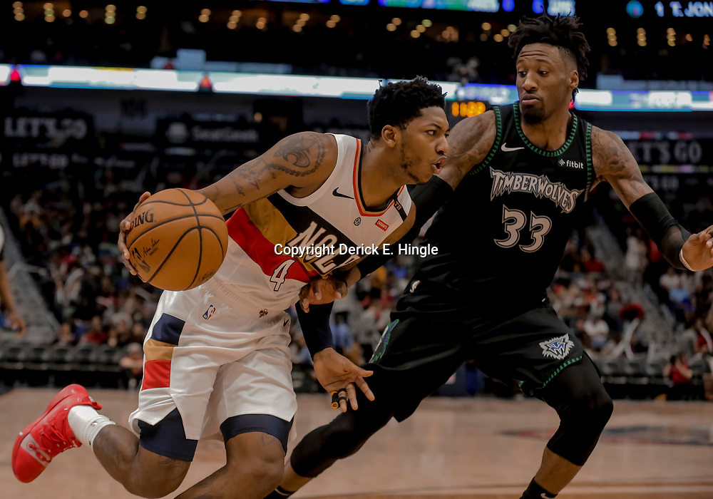 Dec 31, 2018; New Orleans, LA, USA; New Orleans Pelicans guard Elfrid Payton (4) drives past Minnesota Timberwolves forward Robert Covington (33) during the second half at the Smoothie King Center. Mandatory Credit: Derick E. Hingle-USA TODAY Sports