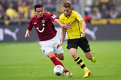 19.10.2013, Signal Iduna Park, Dortmund, GER, 1. FBL, GER, 1. FBL, Borussia Dortmund vs Hannover 96, 9. Runde, im Bild Zweikampf zwischen Edgar Prib (#7 Hannover), Erik Durm (#37 Dortmund) // during the German Bundesliga 9th round match between Borussia Dortmund and Hannover 96 Signal Iduna Park in Dortmund, Germany on 2013/10/19. EXPA Pictures &copy; 2013, PhotoCredit: EXPA/ Eibner-Pressefoto/ Kurth<br /> <br /> *****ATTENTION - OUT of GER*****
