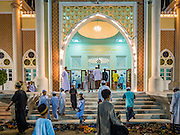 18 JUNE 2015 - PATTANI, PATTANI, THAILAND:  Men file into Pattani Central Mosque for services on the first day of Ramadan. Thousands of people come to Pattani Central Mosque in Pattani, Thailand, to mark the first night of Ramadan. Ramadan is the ninth month of the Islamic calendar, and is observed by Muslims worldwide as a month of fasting to commemorate the first revelation of the Quran to Muhammad according to Islamic belief. This annual observance is regarded as one of the Five Pillars of Islam. Islam is the second largest religion in Thailand. Pattani, along with Narathiwat and Yala provinces, all on the Malaysian border, have a Muslim majority.    PHOTO BY JACK KURTZ