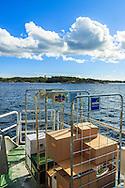 Båt frakt med passbåt till Arholma i Stockholms skärgård. / Stockholms archipelago Sweden.