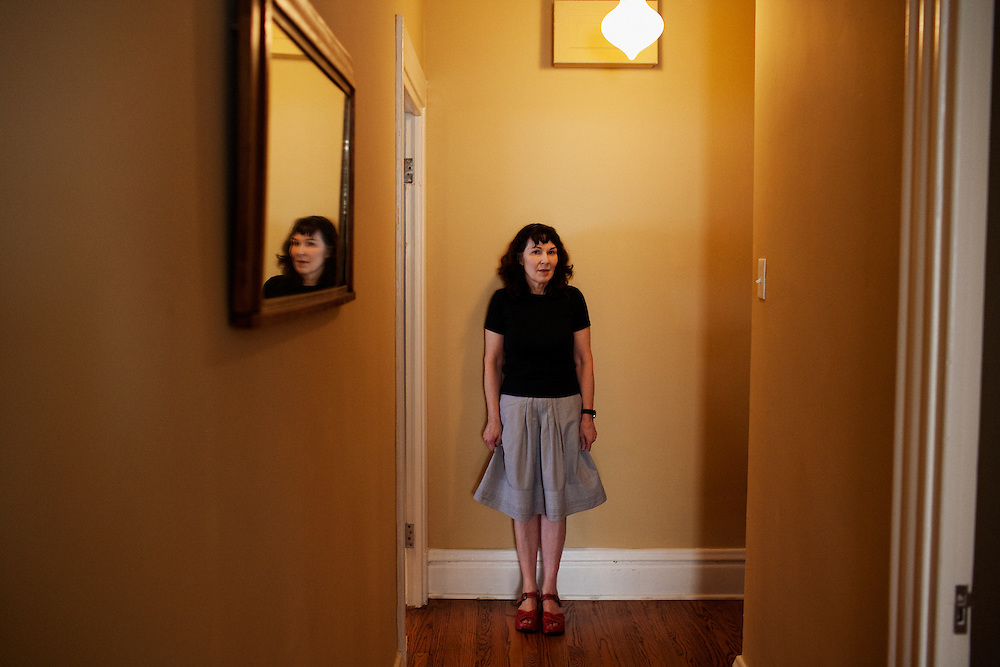 """Poet Mary Jo Bang in her apartment in St. Louis, Missouri on May 12, 2008 shortly after the publication of """"Elegy"""" a collection of poems dedicated to Mary Jo's son, Michael, who died tragically in 2004. Originally photographed for Newsweek."""