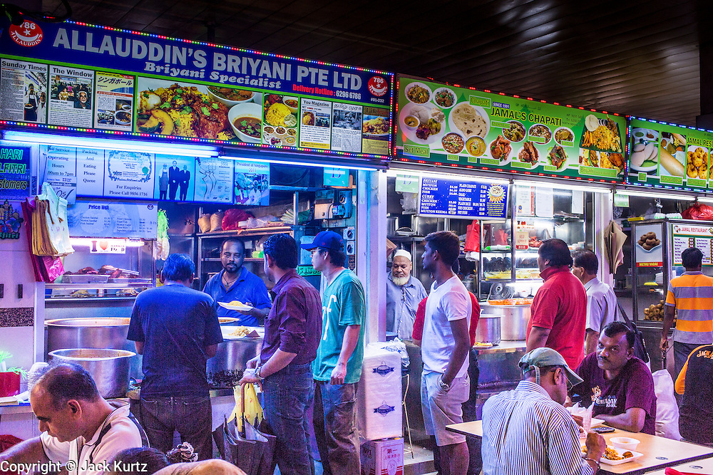 "18 DECEMBER 2012 - SINGAPORE, SINGAPORE:  The prepared food section of Tekka Market in the Little India section of Singapore. The city/state of Singapore moved food hawkers off the streets years ago and put them in the markets and other public areas creating small ""food courts"" all over the city.     PHOTO BY JACK KURTZ"