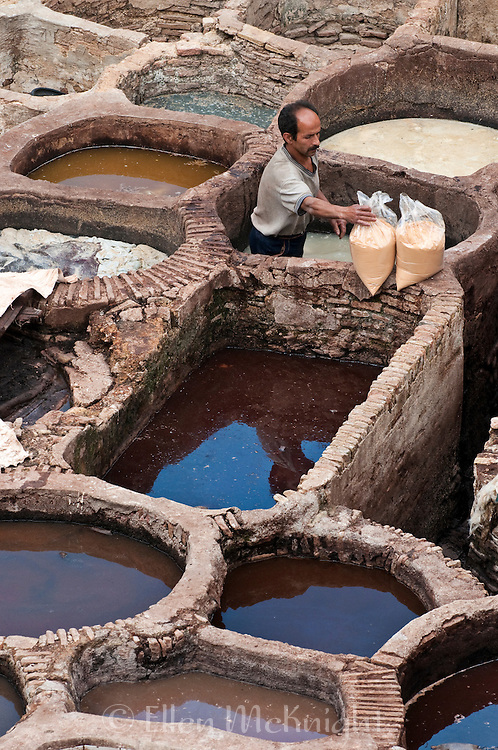 Leatherworker in a dye vat at a Tannery in Fes Morroco