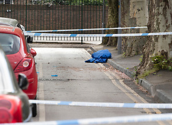 © Licensed to London News Pictures. 02/05/2019. London, UK. Plastic sheeting and medical gloves lie in the road behind a police cordon at Somerford Grove in Hackney where a 15 year old boy was stabbed to death last night. Scotland Yard say police were called just before 9.00pm.The boy was pronounced dead at the scene at 9.49pm. Photo credit: Peter Macdiarmid/LNP
