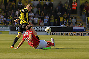 Coventry City defender Aaron Martin tackles Burton Albion forward Stuart Beavon during the Sky Bet League 1 match between Burton Albion and Coventry City at the Pirelli Stadium, Burton upon Trent, England on 6 September 2015. Photo by Simon Davies.