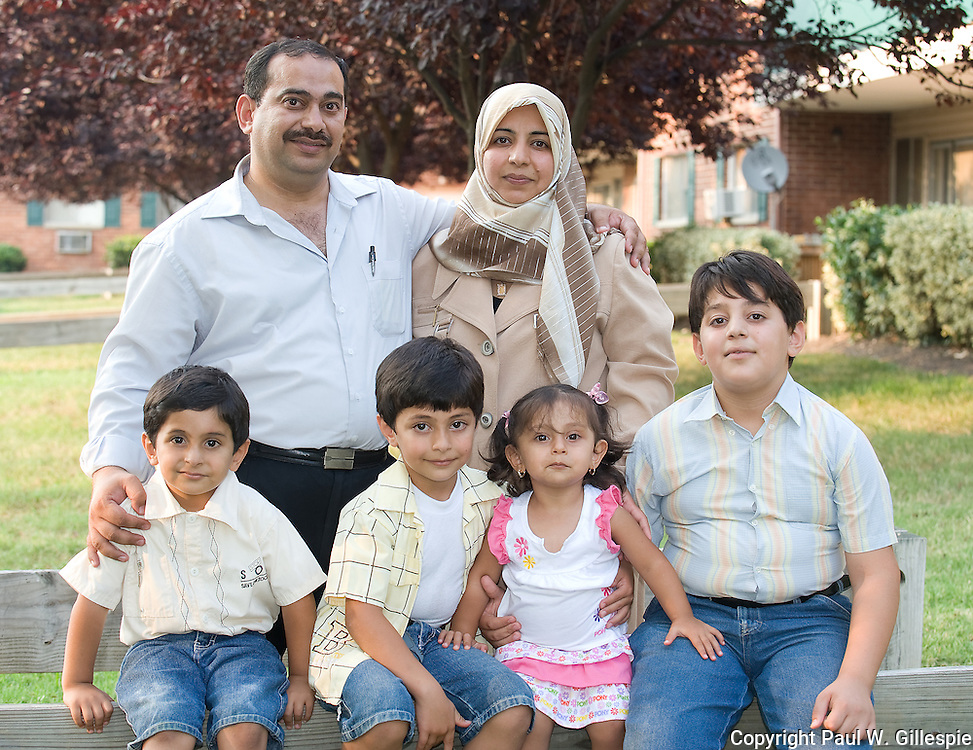 Front (L to R) Sons Abdullah Yahya (5), Haider Yahya (7), daughter Rahaf Yahya (2), son Ahmed Yahya (11). Back (L to R) Mohammed Yousuf and wife Susan Mohammed.  Mohammed Yousuf and his family came to the U.S. in February 2009 as refugees from Iraq. The now live in Prince George's County, MD. During the war Mohammed was a translator for the U.S. military and embassy. Before 2003 he was a veterinarian. Photo by Paul W Gillespie 7/6/10.