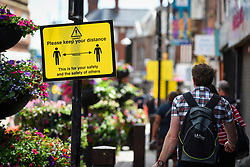 © Licensed to London News Pictures. 13/06/2020. WATFORD, UK.  Keep your distance signs for shoppers in Watford High Street.  To try to stimulate the economy, the UK Government is easing coronavirus pandemic lockdown restrictions to permit non-essential shops to re-open on 15 June, but only if they are Covid19 compliant.  Shoppers will also need to practice social distancing.  After a record 20.4% reduction in gross domestic product (GDP) in April, the country is on course for the worst recession in more than three centuries.  Photo credit: Stephen Chung/LNP