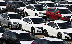 File photo dated 04/08/16 of new cars at Southampton Docks. New car sales fell last month as the General Election put potential buyers off from making a purchase, an industry body has said.