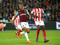 April 16, 2018 - London, England, United Kingdom - L-R West Ham United's  Joao Mario  and Stoke City's Kurt Zouma .during English Premier League match between West Ham United and Stoke City at London stadium, London, England on 16 April 2018. (Credit Image: © Kieran Galvin/NurPhoto via ZUMA Press)