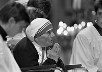 Mother Teresa of Calcutta prays during a special afternoon of prayer at Sligo Cathedral, where she also recieved the Freedom of the City, 16/06/1996 (Part of the Independent Newspapers Ireland/NLI Collection).