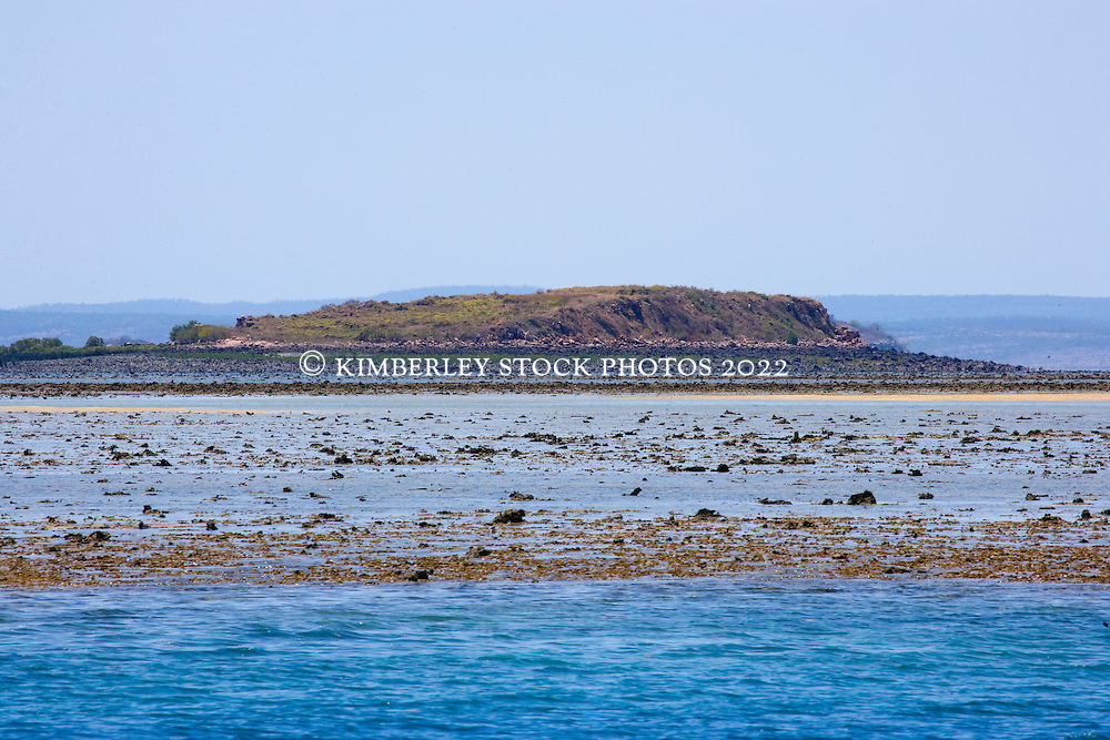 Montgomery Island is visible over Montgomery Reef.  On a falling tide the reef appears to rise from the ocean as water flows off the reef.  At 292km2, Montgomery is Australia's largest inshore reef.