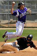 Kansas State shortstop Eli Rumler (leaping) forces out Oklahoma State's Keanon Simon at second base in the top of the fifth inning.  Oklahoma State defeated K-State 9-4 in 10 innings at Tointon Stadium in Manhattan, Kansas, April 30, 2006.