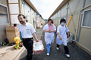 Dr. Sen Hiraizumi poses for a photo outside the Yamada  town Prefectural Hospital in Yamada town, Iwate Prefecture, Japan on  10 June 20011.  .Photographer: Robert GilhoolyDr. Sen Hiraizumi and two nurses, Fumie Ooi and.Etsuko Noda, visit a patient at a temporary housing unit in Yamada town, Iwate Prefecture, Japan on  10 June 20011. With the prefectural hospital in Yamada badly damaged by the March 11 quake and tsunamis, hospital staff have followed Hiraizumi's lead to take their expertise to those in need. Robert Gilhooly photo