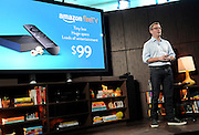 Amazon's Peter Larsen introduces Amazon Fire TV during a press conference in New York, Wednesday, April 2, 2014.  At $99, Amazon Fire TV is the easiest way to watch Netflix, Prime Instant Video, Hulu Plus, WatchESPN, and more on your big-screen TV.  (Photo by Diane Bondareff/Invision for Amazon/AP Images)