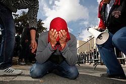 A protestor breaks down in tears after prayers during a protest outside the Libyan Embassy in Attard, outside Valletta, February 22, 2011. The protest was organised by the Libyan community living in Malta against the Libyan government's crackdown on demonstrators in Libya..Photo by Darrin Zammit Lupi