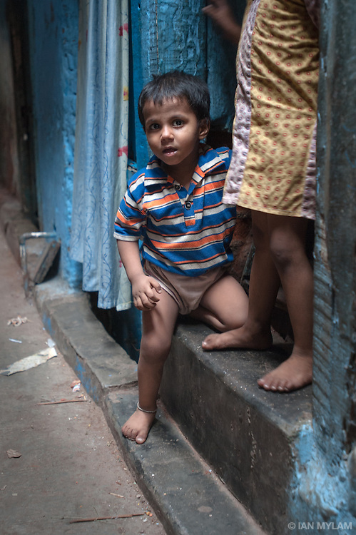 Young Boy on a Doorstep - Dharavi, Mumbai, India